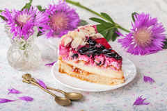 Raspberry and currant cheesecake with cornflowers Royalty Free Stock Photos