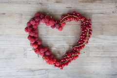 Raspberry and currant heart. In the centre of table. Close up image Royalty Free Stock Photo