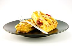 Raspberry Danish on a Black Plate Royalty Free Stock Photo