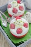 Raspberry a dessert. Two glasses of raspberry dessert with vanilla cream Royalty Free Stock Photos