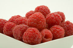 Raspberry dessert. On a white background stock photography