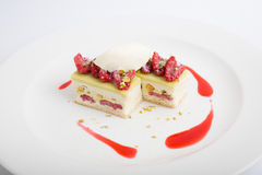 Raspberry dessert cake. With icecream and pistachios Stock Images