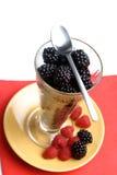 Raspberry dessert. Fresh raspberries and blacberries dessert Royalty Free Stock Image