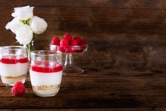 Raspberry dessert from whipped white chocolate mousse and raspbe. Raspberry dessert from whipped white chocolate mousse, raspberry puree as jelly, and base from Stock Images