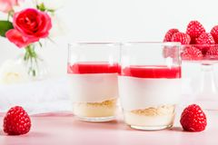 Raspberry dessert from whipped white chocolate mousse and raspbe. Raspberry dessert from whipped white chocolate mousse, raspberry puree as jelly, and base from Stock Photo