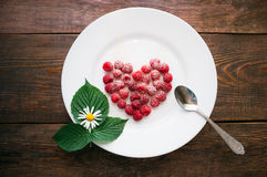 Raspberry dessert on a white plate Stock Photos