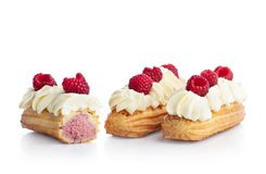 Raspberry eclairs isolated on white. stock image