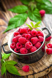 Raspberry. Fresh raspberry with green leaves Royalty Free Stock Images