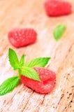 Raspberry. Fresh juicy raspberries on a wooden background Royalty Free Stock Photos