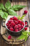 Raspberry. Fresh raspberry with leaves on a table Royalty Free Stock Photography