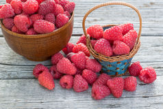 Raspberry. Fresh Organic Raspberry in Blue Basket and wooden bowl on wooden boards Stock Photos