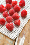 Raspberry in front of white fabric on old vintage wooden tab Stock Images