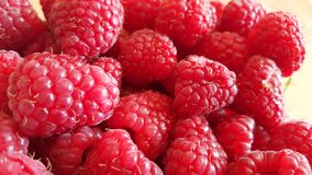 Raspberry fruit background. Fresh raspberries background closeup photo Stock Image