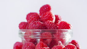 Raspberry fruit heap rotating on white stock footage
