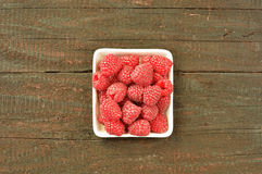 Raspberry. Fruit on wood background. Forest fruit in white idaeus. Delicious fresh berries Royalty Free Stock Photography