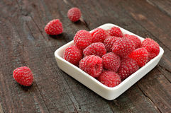 Raspberry. Fruit on wood background. Forest fruit in white idaeus. Delicious fresh berries Stock Images