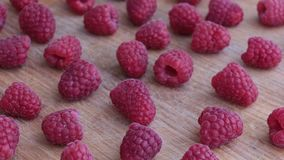 Raspberry Fruit on Wooden Background. stock footage