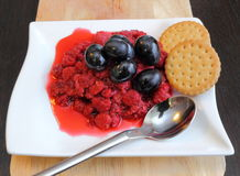 Raspberry with grapes and biscuits Royalty Free Stock Image