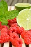 Raspberry, green lemon and mint Stock Photo