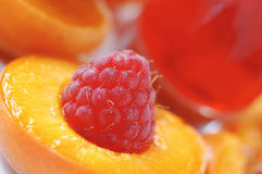 Raspberry in halved peach Stock Image
