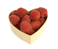 Raspberry heart. Heart shaped box filled with raspberries. Isolated on white Royalty Free Stock Photos