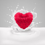 Raspberry heart with milk Stock Photos