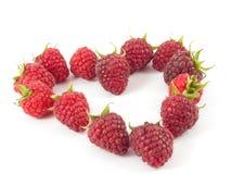 Raspberry Heart  on white. Photo raspberries in a heart Royalty Free Stock Photo