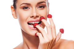 Raspberry on her fingers. Royalty Free Stock Photo