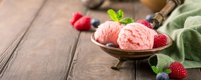 Raspberry ice cream in copper bowl. Royalty Free Stock Photography