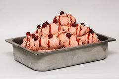 Raspberry ice cream in the metal tray. On white background Royalty Free Stock Image