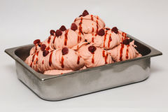 Raspberry ice cream in the metal tray. On white background Royalty Free Stock Photo