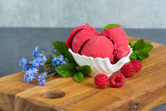 Free Raspberry Ice Cream Sorbet In White Porcelaine Bowl With Raspberry, Mint Leaves Copy Space On Wooden Plank And Grey Textured Stock Photo - 92336900