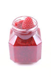 Raspberry jam. Jar of raspberry jam and some fresh berry isolated on white Stock Photography