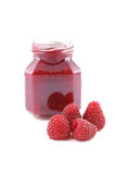 Raspberry jam. Jar of raspberry jam and some fresh berry isolated on white Royalty Free Stock Photo