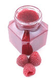 Raspberry jam. Jar of raspberry jam and some fresh berry isolated on white Royalty Free Stock Photography