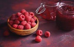 Raspberry Jam. Basket of fresh raspberries and a jar of raspberry jam Stock Photography