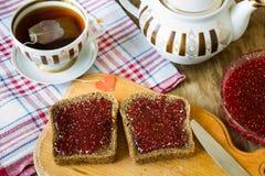 Raspberry jam and blak bread royalty free stock photo