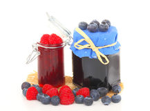 Raspberry jam and blueberry jelly Royalty Free Stock Photos