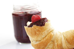 Raspberry jam and croissant on plate Royalty Free Stock Images