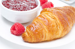 Raspberry jam and croissant on a plate Royalty Free Stock Photo