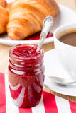 Raspberry jam and croissants. Royalty Free Stock Image