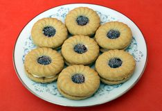 Raspberry jam and custard biscuits or cookies Stock Images