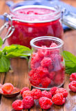 Raspberry and jam. Fresh raspberry and jam in glass bank Royalty Free Stock Photo