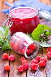 Raspberry and jam. Fresh raspberry and jam in glass bank Royalty Free Stock Photography