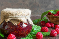 Raspberry jam and fresh raspberry on a rustic wooden table Royalty Free Stock Photos