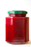 Raspberry jam in hexagonal jar. (1) with clipping path Royalty Free Stock Images