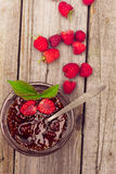Raspberry jam in a jar and fresh berries on the wooden table. Raspberry jam ( marmalade ) in a jar and fresh raspberry on a rustic wooden table.Selective focus Royalty Free Stock Photography