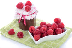 Raspberry jam jar with fresh raspberries. On a dish towel Royalty Free Stock Image