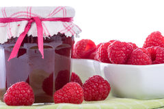 Raspberry jam jar with fresh raspberries. On white background Royalty Free Stock Photography