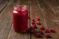 Raspberry jam in jar. Fresh raspberry on rustic wood table. Wood texture Royalty Free Stock Image